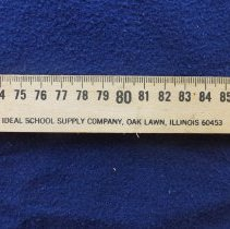 Image of Ideal School Supply Ruler - This item is a ruler produced by the Ideal School Supply Company located at 11000 LaVergne in Oak Lawn.  It is a meter in length and contains various conversion charts.
