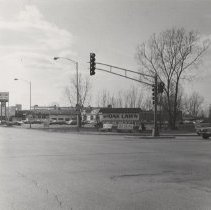 Image of 95th Street and Crawford (Pulaski) Road - This item is a photograph of 95th Street and Crawford (Pulaski) Road looking northwest. Jack Thompson Oldsmobile can be seen in the foreground while Christ Hospital is visible on the far left.