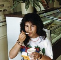 Image of A Weekend in the Life of Oak Lawn - This is a photograph of everyday life in Oak Lawn during 1987. It features Amy Galvasam enjoying a frozen treat at the TCBY store located at 95th and Ridgeland Avenue.