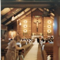 Image of A Weekend in the Life of Oak Lawn - This is a photograph of everyday life in Oak Lawn during 1987. A photographer sets up equipment at a wedding taking place at St. Geralds Church located at 9310 S. 55th Court.