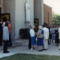 Image of A Weekend in the Life of Oak Lawn - This is a photograph of everyday life in Oak Lawn during 1987. Guests congregate outside St. Geralds Church located at 9310 S. 55th Court after a wedding.