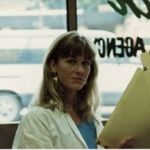 Image of A Weekend in the Life of Oak Lawn - This is a photograph of everyday life in Oak Lawn during 1987. It features Allison Gary at the Buschbach Insurance Agency located at 5615 W. 95th Street.