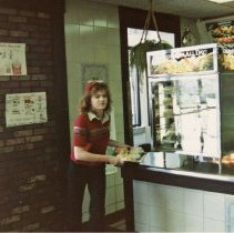 Image of A Weekend in the Life of Oak Lawn - This is a photograph of everyday life in Oak Lawn during 1987. It Wendy Norton, an employee at the McDonald's located at 9128 S. Cicero, with a tray of food.