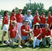 Image of A Weekend in the Life of Oak Lawn - This is a photograph of everyday life in Oak Lawn during 1987. It features American Cancer Society volunteers with Mickey Farrell, manager, (center, blue shirt), at the Stony Creek Driving Range.
