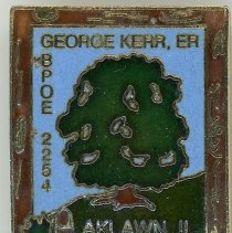 Image of Benevolent and Protective Order of the Elks Pin - This item is a pin used by George Kerr, a member of the Benevolent and Protective Order of the Elks Oak Lawn chapter. It is blue and green in color and features the image of a tree.
