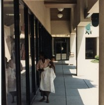 Image of A Weekend in the Life of Oak Lawn - This is a photograph of everyday life in Oak Lawn during 1987. It features Angeline Marshall and her daughter Faith Nicole window shopping in Coral Plaza located in the 4700 block of W. 95th Street.