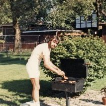 Image of A Weekend in the Life of Oak Lawn - This is a photograph of everyday life in Oak Lawn during 1987. It features Brian Birch cooking on a backyard grill at 7940 W. 89th Place, Hickory Hills, IL.