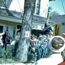 "Image of Oak Lawn Round-Up, 1954 - This is a photograph of the 1954 Oak Lawn Round-Up. It features one of the mock events staged during Round-Up in which lawmen prepare to administer ""frontier justice"" on now captured desperado, as the crowd, some in costume and some not, look on."