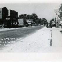 Image of 95th Street Looking West - This is a photograph of 95th Street looking west from approximately 52nd Avenue. On the south side of street from left to right are Rupich's Drug Store and A&P Store. On the north side of street are Nick's Tavern, Cook Avenue, Sinclair Gas Station, the Hilgendorf House, Hearty Eat Shop and Behrend's Hardware Store.