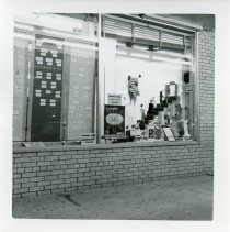 Image of Shoppers World Display - This is a photograph depicting a window display in Shoppers World located at 9639 Cicero Avenue in Oak Lawn. The display promoted National Business Women's Week.