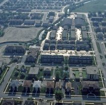 Image of Aerial Photograph of Stony Creek - This is a slide taken in 1982 featuring an ariel view of Stony Creek between 103rd Street and 105th Street and Central Avenue. 103rd Street is visible in the upper left of the picture. Central Avenue is visible from left to right at the top of the picture. 105th Street is running from top to bottom on the right side of the picture. The Oak Lawn Park District Racquet Club located at 10444 S. Central can be seen just right of Stony Creek in the upper middle of the picture. There are many apartment buildings visible. In the upper right side of the picture the Richards High School track and football field are visible as is a small part of the school itself.