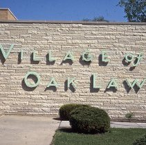 Image of Village Hall - This is a slide taken in 1977 featuring a view of the sign on the Oak Lawn Village Hall located at 5252 James (Dumke Dr.).