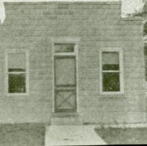 Image of Village Hall - This is a slide featuring a view of the first Village Hall located at 9437 South Cook Avenue circa 1912.