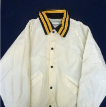 Image of Harold L. Richards High School High School Jacket - This item is a volleyball jacket from Harold L. Richards High School. It is white in color and has brown and yellow lettering on the back.