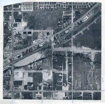 Image of Aerial Photograph of Oak Lawn - This item is an aerial photograph of Oak Lawn taken around 1955. 95th Street is visible on the bottom while Cicero Avenue runs along the left side. The railroad tracks cut across the center of the image and numerous structures and homes can be seen.