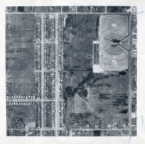 Image of Aerial Photograph of Oak Lawn - This item is an aerial photograph of Oak Lawn taken around 1955. 87th Street is visible near the top and Cicero Avenue can be seen on the right. Rows of new homes stretch across the center and the Twin Drive-In Theater stands in the top right corner.