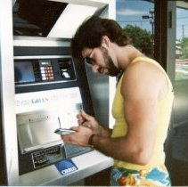 Image of A Weekend in the Life of Oak Lawn - This is a photograph of everyday life in Oak Lawn during 1987. It features Anthony Montesan at an ATM machine located at the Oak Lawn National Bank located at 9400 S. Cicero Avenue.