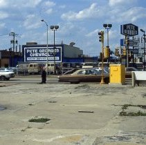 Image of 95th & Cicero Avenue - This is slide featuring a view looking north from the southwest corner of 95th Street at Cicero Avenue. The Goodyear Auto Center located at 4810 W. 95th Street is partially visible on the left and just north is Pete Georges Chevrolet located at 9440 S. Cicero Avenue. Traffic moving east and west on 95th Street is visible and some pedestrians can be seen making their way along the sidewalk on the south side of 95th Street. In the background, signs for other businesses, Denny's and Kole Pontiac, can be seen.