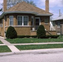 Image of 53rd Court House - This is a slide featuring a view of the house, a classic Chicago-style brick bungalow, located at 9340 S. 53rd Court circa 1984.