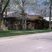 Image of 53rd Court - This is slide is a view of the west side of the 9300 block of 53rd Court, circa 1984, featuring a row of classic Chicago-style brick bungalows.