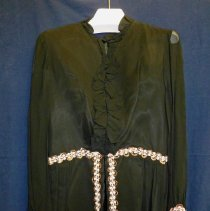 Image of St. Gerald Showtime Costume - This item is a costume used by Mary Lou Harker during a performance of St. Gerald's Showtime. It is black in color with pink trim and shorts.