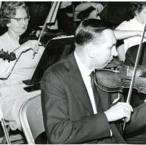 Image of Southwest Symphony Orchestra Rehearsal - This is a photograph of two members of the Southwest Orchestra concentrating on their music at a rehearsal, Frieda Durkin, 9847 Leavitt Ave., Chicago, and Daniel J. Seyman, concertmaster of the orchestra, 10304 Long Ave., Oak Lawn.