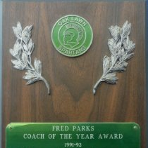 Image of Chuck Chilvers Football Plaque - This item is a plaque awarded to Oak Lawn Community High School football coach Chuck Chilvers for his demonstration in dedication, caring and leadership. It features an image of a Spartan and several branches.