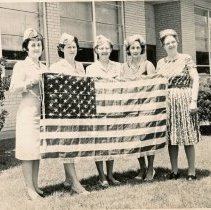 Image of V. F. W. Women's Auxiliary presents flag to Harnew School - This is a photo of the Johnson-Phelps V. F. W. Post 5220 Women's Auxiliary members presenting flag to Harnew School located at 91st Street and Austin Avenue. l-r: Jean Zemail, Dorothy Hejl, Lucille Perschau, Mildred Dawkins, Gladys Baldwin.