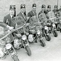Image of Southwest Suburban Medina Shriner's Club Motorcyclists - This is a photograph of the Southwest Suburban Shriner's Club Motorcyclists. Left to right: Wolfgang Reinke-Commader-Oak Forest; Dr. Paul B. Stoxen-1st Captain & Secretary-Palos Park; Richard Case-2nd Captain & Treasurer-Orland Park; John Allyn-1st Leut.-Palos Heights; Phil Elliott-1st Leut.-Palos Heights; Bob Telander-Evergreen Park; Irv Armbruster-Oak Lawn; Wendell Spencer-Orland Park; Milfred Bettengausen-Tinley Park; Bill Lilly-Palos Park; Bill Peak-Dolton.