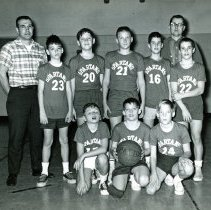 Image of Spartans Y.M.C.A.Basketball Team - This is a photograph of the Spartans basketball team, which had the lead in the Biddy League of the Oak Lawn Y.M.C.A. with a 10-0 standing at the time this picture was taken. 