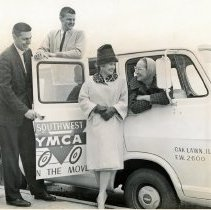 """Image of Service League Helps """"Y"""" Go Mobile - This is a photograph of a van purchased by the Service League and given to the Oak Lawn Y.M.C.A. l-r: Richard Younger, Buddy Stanford, Mrs Robert Keck, Mrs. Richard Barz."""
