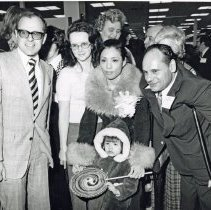 Image of Venture Store Grand Opening - This is a photograph of the grand opening ribbon-cutting ceremony of the Venture store located at 4101 W. 95th Street. l- r: Fred Rueff, store manager; unidentified; Mrs. Riordan, customer; Lee Ann Riordan, unidentified child; Fred M. Dumke, Mayor.
