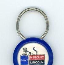Image of Van Dahm Lincoln-Mercury Keychain - This item is a keychain produced by Van Dahm Lincoln-Mercury located at 10201 South Cicero Avenue in Oak Lawn. It is blue and white in color and features a logo on the front.