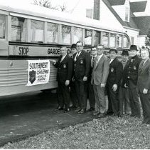 Image of Sertoma Donates Bus to Garden School for the Handicapped - This is a photograph of Sertoma presenting a new school bus to Garden School for the Handicapped. l-r: Frank De Lordo, Southwest Sertoma Club president; Ray Sullivan, Sertoma member; Robbie Starr, Sertoma member; Ralph Starr, Sertoma member; Mike Coglianese, Garden School for the Handicapped board president; Dom Pelegrino, Sertoma member; Frank Pelegrino, Sertoma member; Bill Hertzer, Sertoma member; Bob Norris, Garden School for the Handicapped business administrator.