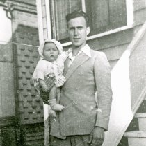 Image of Walter and Judy Wettergren - This is a photograph of Walter Wettergren holding his daughter, Judy Wettergren.