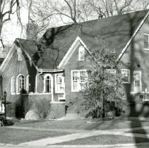 Image of 9349 S. 53rd Court House - This is a photograph of a house located at 9349 S. 53rd Court (northeast corner of Oak Street and 53rd Court). A manger scene complete and a star with streaming lights decorates the home as a man and a dog make their way along the sidewalk.