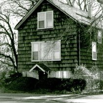 "Image of 4201 W. 103rd Street House - This is a photograph of a house located at 4201 W. 103rd Street. Built in 1913 as a farmhouse and possibly originally located on 102nd Street, it consisted of heavy timbers and square nails. When the land was subdivided for houses in 1927, Mr. Emmett ""Bud"" Meyer purchased the home in 1928 and had it moved to its location at 4201 W. 103rd Street and set on a high basement. Mr. Meyer and his wife, Jeanie, ran his business, Emmett R. Meyer Real Estate from the basement of the home. The home has since been demolished."