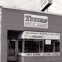Image of 95th Street Oak Lawn Businesses - This is a photograph of Tuziks 95th St. Bakery located at 4955 W. 95th Street.  It features the storefront window and sign above the store.