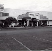 Image of 95th Street Oak Lawn Businesses - This is a photograph of Modern Tuxedo Center, Smith Furriers, and Chicago Title Insurance Company. It features a sign to the right advertising all three stores. The addresses in this plaza ranged from 4930 to 4954 W. 95th Street.