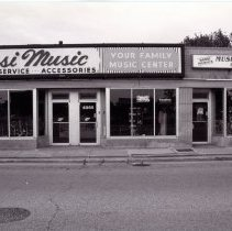 Image of 95th Street Oak Lawn Businesses - This is a photograph featuring the storefronts of Rossi Music located at 4865 W. 95th Street and Rossi Music's Musician's Toy Box, which featured music, gifts and apparel.