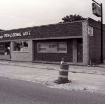 Image of 95th Street Oak Lawn Businesses - This is a photograph of the Village Professional Arts strip which includes Village Pharmacy located at 5019 W. 95th Street and a doctor's office at 5021 W. 95th Street. Road construction is being done in front of the building on 95th Street.