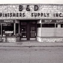 Image of 95th Street Oak Lawn Businesses - This is a photograph of B & D Refinishers Supply Inc. located at 5005 W. 95th Street.  It features the storefront windows and the name of the store above them.