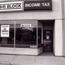 Image of 95th Street Oak Lawn Businesses - This is a photograph of H & R Block Income Tax located at 4961 W. 95th Street.  It features the storefront windows and store name above.