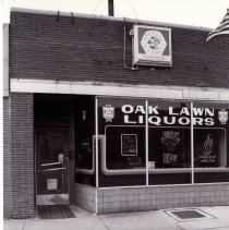 Image of 95th Street Oak Lawn Businesses - This is a photograph of Oak Lawn Liquors and Lounge located at 4913 W. 95th Street.  It features the storefront windows with signs advertising different beers served.
