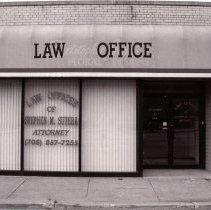 "Image of 95th Street Oak Lawn Businesses - This is a photograph of the Law Offices of Stephen M. Sutera Attorney at 4927 W. 95th Street.  On the store front awning ""Law Office"" has been placed over the previous store's name, Christopher John Floral Designs."
