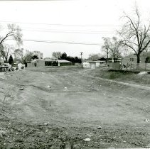 Image of Water Retention Pond - This is a photograph of construction of a water retention pond located at 52nd Avenue and Harnew Road. Six homes were razed to make room for the pond in an effort to resolve flooding of homes in the area during heavy rain storms.