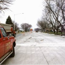 Image of 95th Street and Central Avenue - This is a photograph of repair work at 95th Street and Central Avenue. This picture features of view of the new lanes added to Central Avenue looking north from 95th Street toward Southwest Highway. An Oak Lawn Fire Department vehicle and dump truck are visible in the left of the picture. In the background on the right, the rectory and part of the school building at St. Gerald's can be seen.