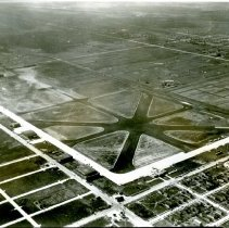 Image of Aerial Photograph of Midway Airport - This is a photograph showing an aerial view of Midway Airport looking northwest from 63rd Street and Cicero Avenue.
