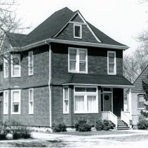 Image of Van Den Berghen House - This is a photograph of the front exterior of the Albert Van Den Berghen home located at 9330 S. 51st Avenue. He was a noted Belgian sculptor who died in the house on October 12, 1921. While he was living there, his attorney, Clarence Darrow, visited him. The house built by carpenter contractor Charles F. Sahs at the age of 25 in 1890s. It is believed that the home was sold to Van Den Berghen in 1916 or 1917.