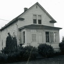 Image of Von Stowver House - This is a photograph of the front exterior of the Robert Von Stowver home located at 5318 W. 89th Street. The building was formerly located at the site of the First Congregational Church, now known as Pilgrim Faith United Church of Christ, located at 9413 S. 51st Avenue. The house was built in 1922. In 1954 when the church sought to expand its facilities, bids were taken to have the house moved or demolished. Robert Von Stowver won the bid and moved the house to its present location on 89th Street.